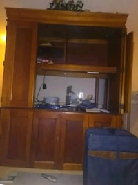 brown wooden TV hutch with flat screen television Tulsa, 74136