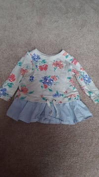 girl's grey, blue, red, and green floral long-sleeved shirt and blue pinstripe mini skirt Centreville, 20120