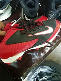 pair of red-and-black Nike cleats Columbia, 29203