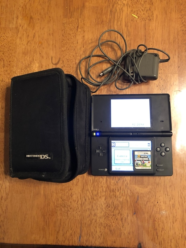 Black nintendo dsi with charger, case, game
