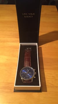 Vincero Collective watch with blue face and leather strap  25 km