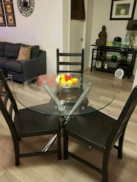 Round glass-top table with 3 chairs Toronto, M5A