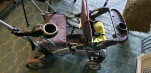 baby's brown and black stroller