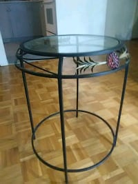 round clear glass-top table with black steel base Toronto, M1B 5X6