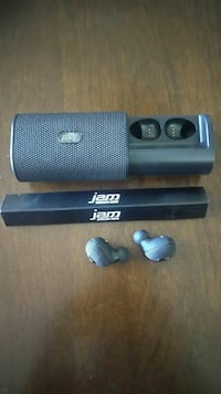 gray cordless earphones and portable speakers