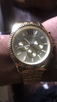 round silver Michael Kors chronograph watch with silver link bracelet