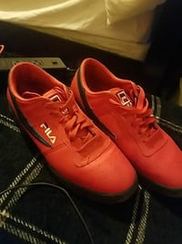 pair of red-and-black Fila low-top sneakers