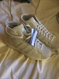 Pair of white adidas superstar Orlando, 32808