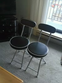 two black leather padded bar stools Surrey, V3V 7W4