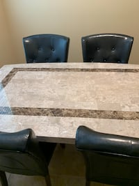 Marble table and chairs. Barely used due to travel for work. Bought for 900 about a year ago. Great deal. May negotiate price of interested Henderson, 89044