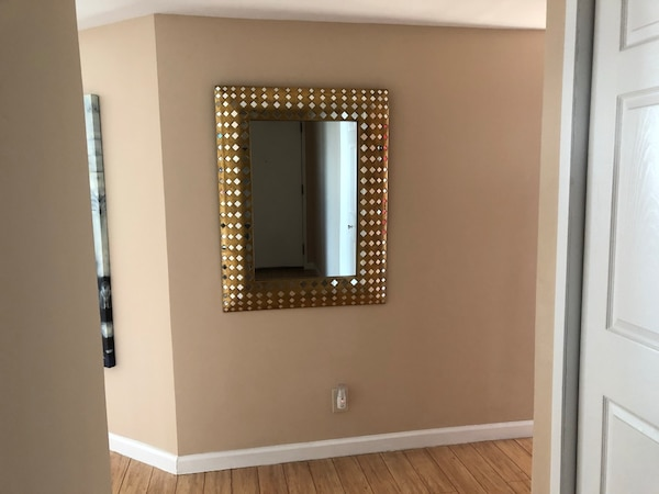 Modern gold wall mirror.