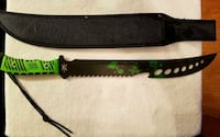 green handled black sword with scabbar d