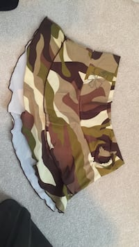 Camo size med skirt nylon.  Can be used over bathing suit