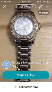 round silver-colored analog watch with link strap screenshot Winnipeg, R2K 3G4