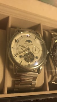 round silver chronograph watch with link bracelet Mississauga, L5M 5V3