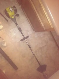 yellow and gray electric string trimmer