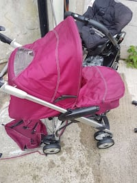 baby's black and pink stroller Rossendale, BB4 6LN