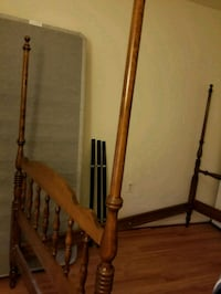 brown wooden bed headboard and footboard Burke