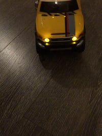 Yellow and black die-cast car 5916 km