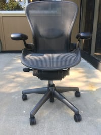 Herman Miller Black Aeron Office chair Size B. Excellent condition with sliding lumbar support and adjustable armrests. Gold standard in office furniture Brandon
