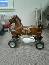 brown ride-on horse toy