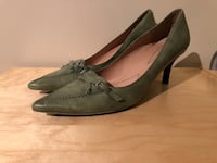 Pair of green leather pointed-toe heels from nine wesr Toronto