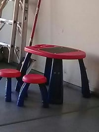 red and black plastic table and chairs