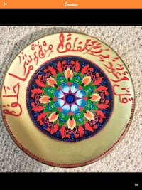 round beige and red decorative plate Alexandria, 22310