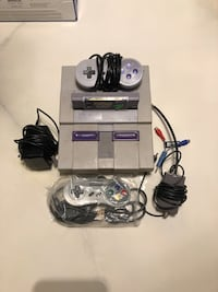 Old Super Nintendo games console with one game
