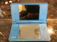 blue Nintendo DS with game cartridge Kirkland, H9H 3W9