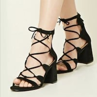 Pair of black leather sandals Falls Church, 22041