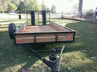 black and brown utility trailer 661 km