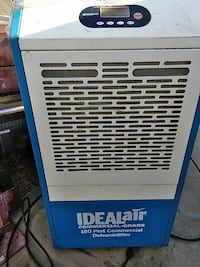 white and blue Ideal Air commercial dehumidifier