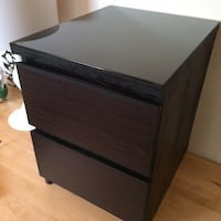 Brown ikea bedside table with glass cover