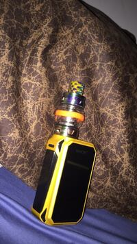 Black and yellow smok alien variable box mod vape