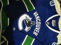 blue and white Vancouver v-neck jersey shirt