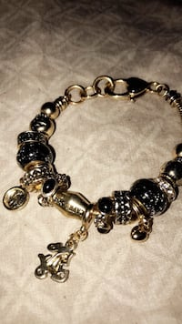 Gold plated and black charm bracelet