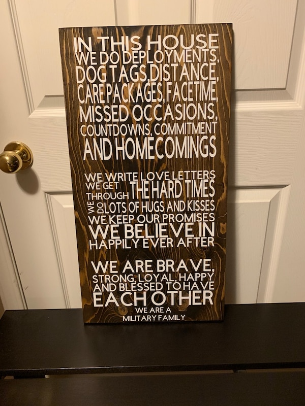 Homemade 'in this house...' military family sign