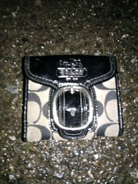 black and gray Coach wallet