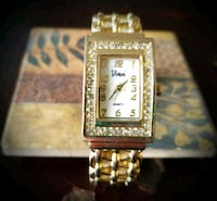 square gold-colored analog watch with link bracele 2260 mi