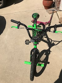 green and black BMX bicycle