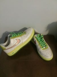 pair of white-and-green Nike sneakers Jacksonville, 32205