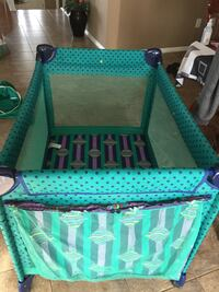 baby's green and blue Pack 'N Play
