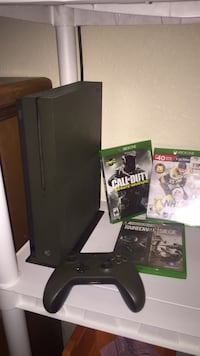 black Xbox One console with controller and game cases Anderson, 96007