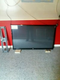 black and red wooden TV stand 110 mi