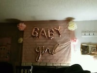 Baby girl shower items banners, balloons, pompoms