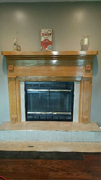 brown wooden fireplace mantle and surround
