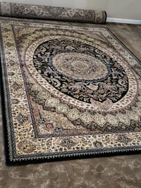 Main color is black, 7'by10' Persian style area rug