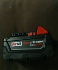 Milwaukee mid torque impact wrench with extra M18 red lithium battery