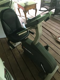 Black and green recumbent stationary bike Winterville, 30683